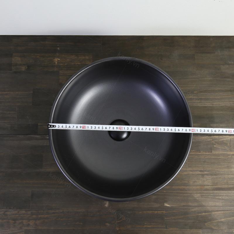 Kích thước đường kính phủ bì của lavabo màu đen khoảng 400mm
