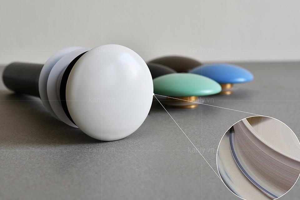 Nút nhấn xả lavabo làm từ chất liệu sứ màu